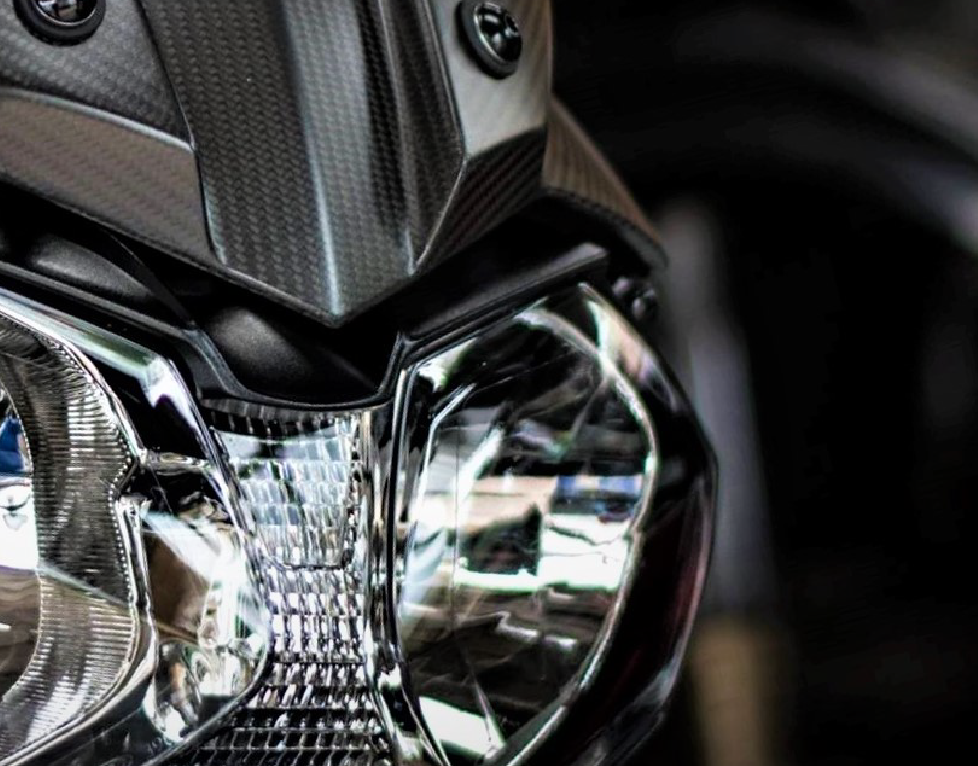 Image of a motorbike headlight from the front